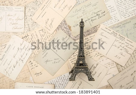 antique french postcards and souvenir Eiffel Tower landmark from Paris. Nostalgic still life