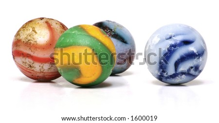 Antique Glass Toy Marbles on a White Background - stock photo