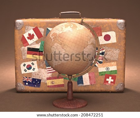 Antique globe in front of a retro suitcase. Travel concept around the world.