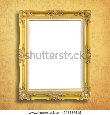 Antique gold frame on paper background - stock photo