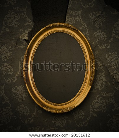 Antique gold frame on wallpaper background - stock photo