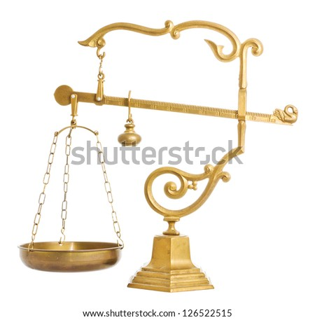 Antique golden brass balance over a white background - stock photo