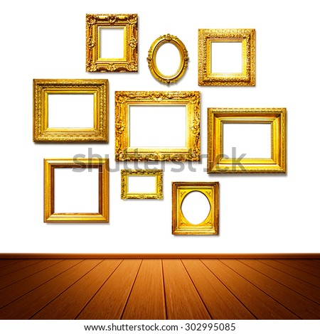 Antique golden frames on the wall. Art gallery. Objects group on white background