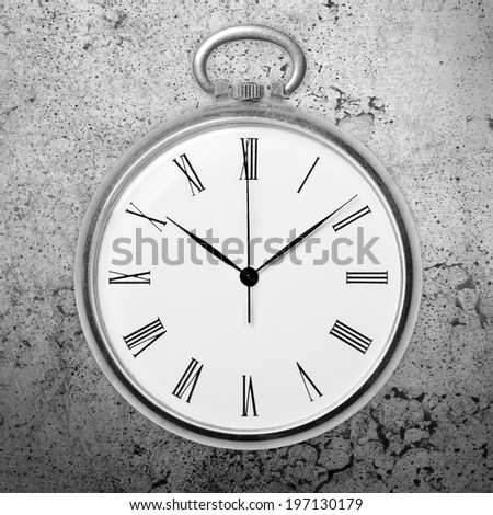 Antique golden pocket watch on grunge background, monochrome. Concept of time, past or deadline - stock photo
