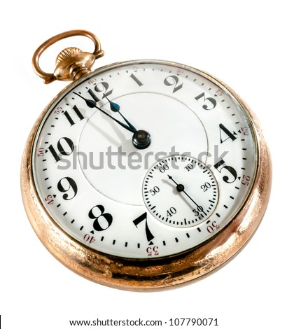 Antique golden pocket watch showing a few minutes to midnight isolated on white background. Concept of time,the past or deadline. - stock photo