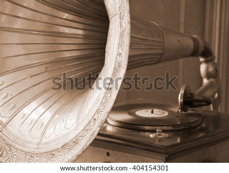 Antique gramophone (in sepia, retro style) - stock photo