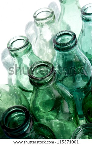 Antique green glass bottles that are no longer manufactured - stock photo