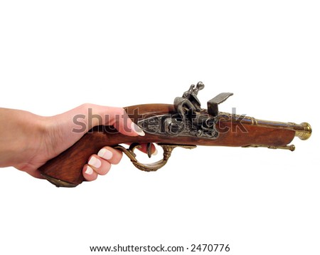 Antique gun in a womanish hand over white