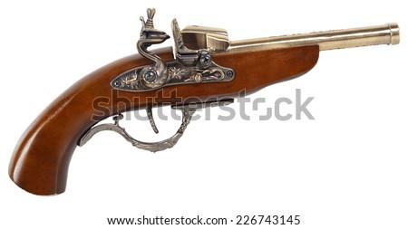 Antique gun isolated on white background - stock photo
