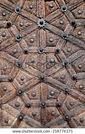 Antique, hand crafted wooden door, Stone Town, Zanzibar - stock photo