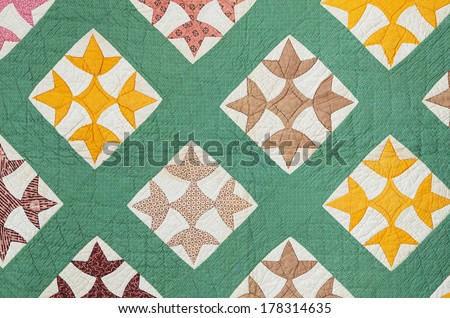 antique hand made quilt from the eastern US made in the late 1800s - stock photo