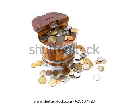 Antique handcrafted wooden money box with small money isolated on a white background - stock photo