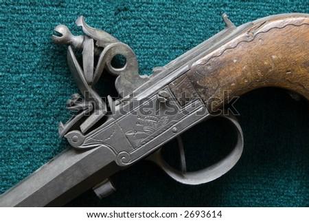 antique handgun hammer - stock photo