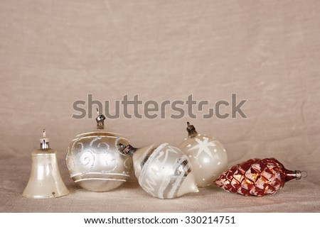 Antique handmade silver Christmas baubles on a row; eye level - stock photo