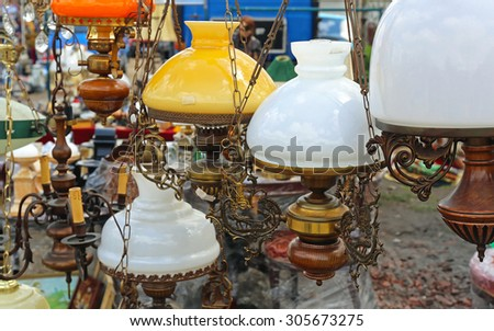 Antique Hanging Lamps And Chandeliers at Flea Market - stock photo