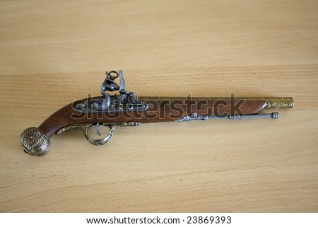 Antique holster on wooden background