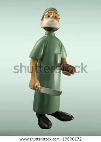 antique humorous doctor figurine - stock photo
