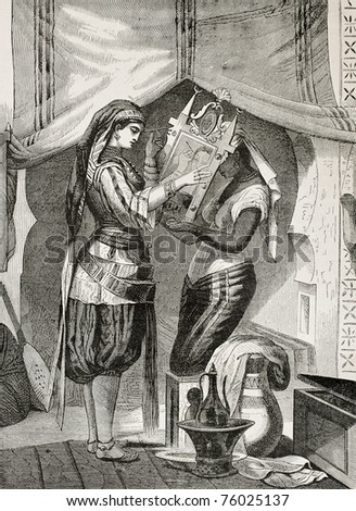 Antique illustration of a muslim woman make-up in front of mirror. Drawing of De Moulignon, published on L'Illustration, Journal Universel, Paris, 1868 - stock photo