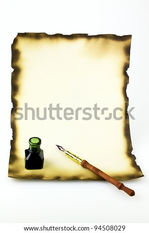 antique ink  pen and inkwell and old paper - stock photo