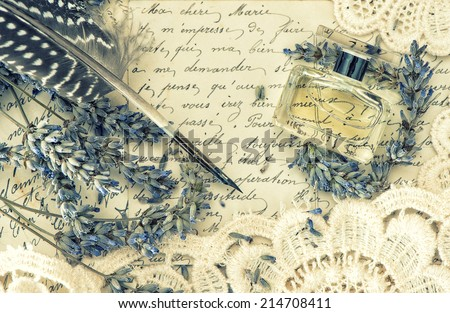 antique ink pen, perfume, old love letters and lavender flowers. retro style toned picture - stock photo
