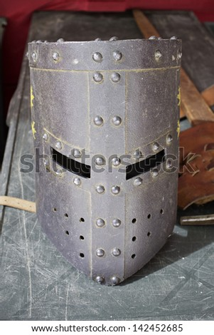 Antique iron medieval helmet in event of recreation, historic - stock photo