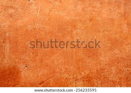Antique italian orange plaster texture background - stock photo