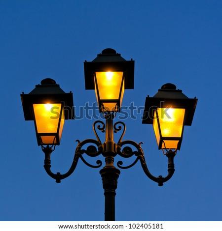 Antique lamp. The urban scene. Object. - stock photo