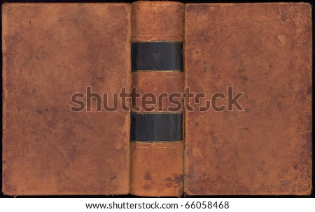 Antique leather book cover with spine over two hundred  years old - stock photo