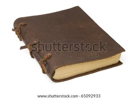 Antique leather notebook isolated on white background - studio shoot - stock photo