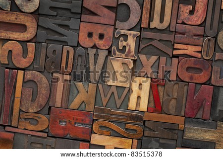 antique letterpress printing blocks with color ink patina, random collection of different size and style - stock photo