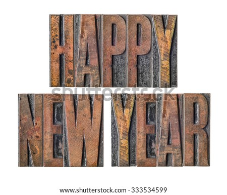 Antique letterpress wood type printing blocks on a white background - Happy New Year - stock photo