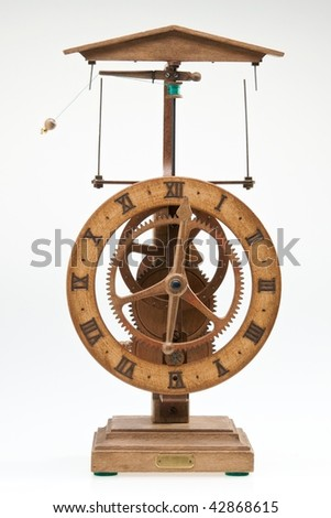 Antique looking clock dial showing time about twelve