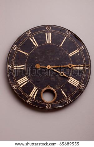 Antique looking dark color wall clock - stock photo