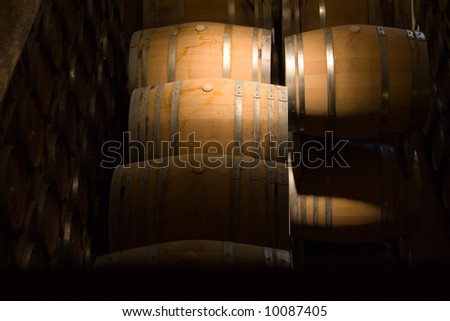 antique looking shot of cellar in winery - stock photo
