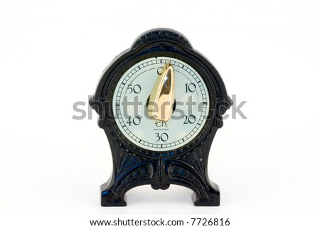 antique looking timer with golden knob