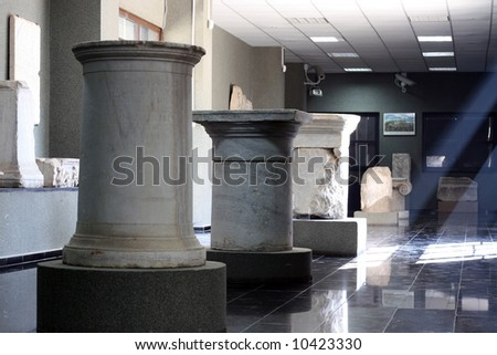 antique marble columns in a museum - stock photo