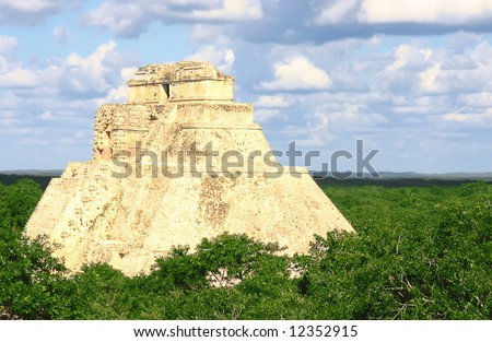 Antique mayan ruins in Mexico over green forest - stock photo