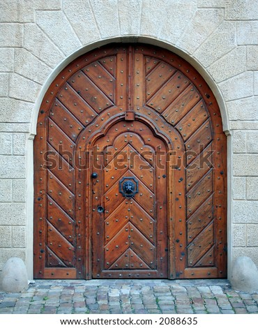 Antique medieval wooden door: concept for entry, gateway, etc. - stock photo