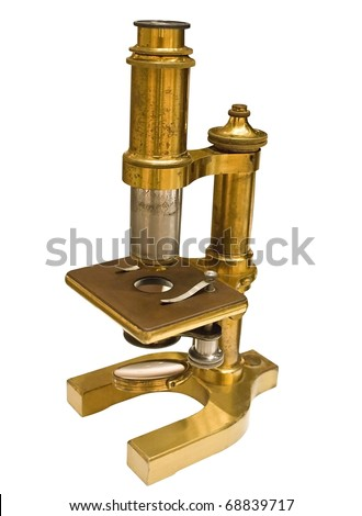 Antique microscope with clipping path. - stock photo