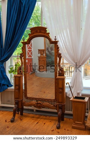 Antique mirror in a wooden carved frame