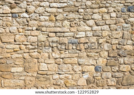 Antique natural stonewall - stock photo