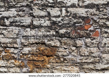 Antique natural stonewall of an old fortress - stock photo