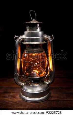 Antique Oil Lamp Lighting up the Darkness - stock photo