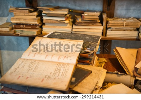 Antique Old Aged Books stacked on a wooden surface - stock photo