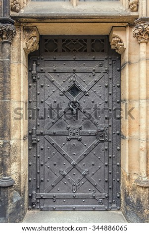 Antique old historical  door of old cathedral in Prague, Czech Republic, Europe. - stock photo