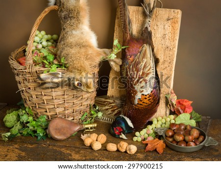 Antique old master hunting still life with pheasant and hare - stock photo