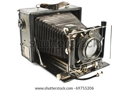 Antique Old photo Camera isolated on white - stock photo