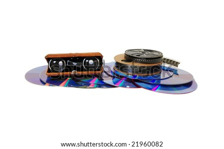 Antique opera glasses used to view distant events, Reels of antique movie film, A couple of purple dvds with red interiors - stock photo