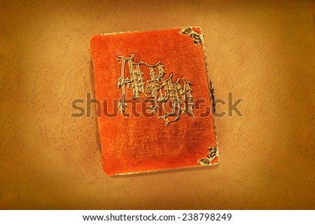 Antique orange photo album from the early part of the 20th century. - stock photo