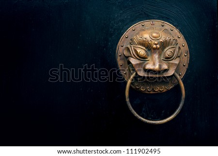 antique oriental door knocker - stock photo
